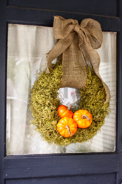 DIY moss and pumpkin wreath