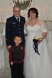 The very special ring bearer with the newlyweds