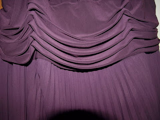 Draped waistline of purple dress