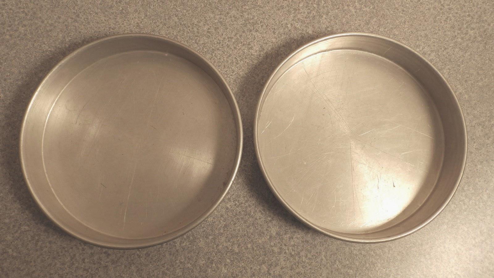 http://www.ebay.com/itm/2-Mirro-aluminum-cake-pans-8-337M-/321692552054?pt=LH_DefaultDomain_0&hash=item4ae65ecb76