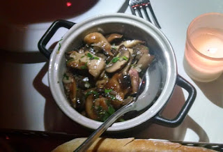 A side of mixed mushrooms complemented the next dish of meat
