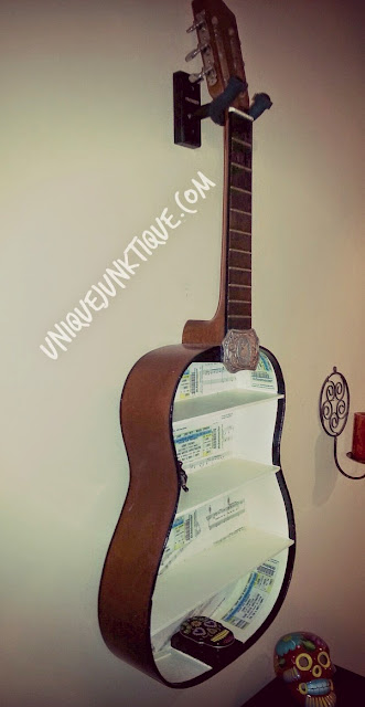 upcycled guiter shelf by unique junktique