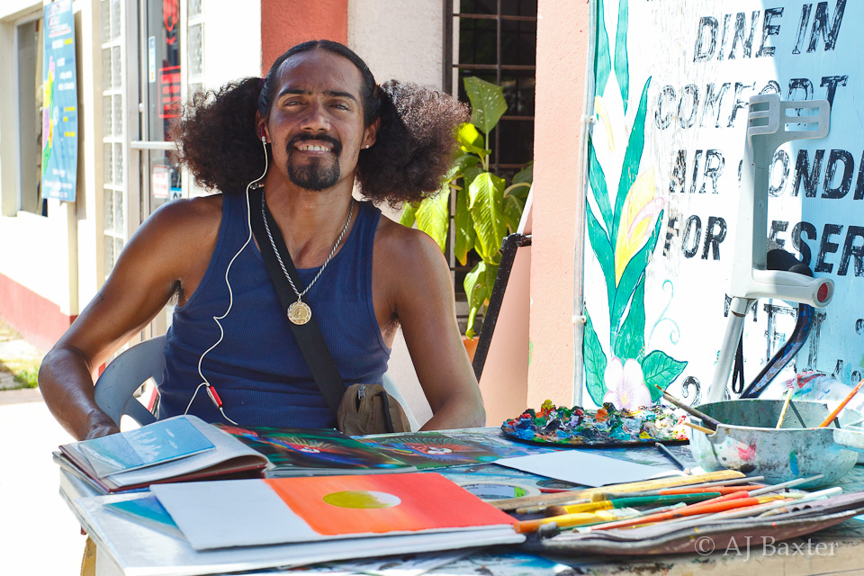 Kirt Cruz, Artist in San Pedro Town, Ambergris Caye, Belize by AJ Baxter