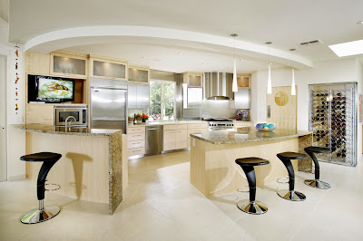 contemporary kitchen design occupying wide space area having stylish marble counter top and stainless steel appliances