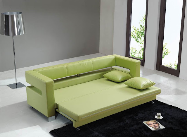 cozy green leather flip sofa bed with green pillows and black fur rug also stainless steel standing lamp
