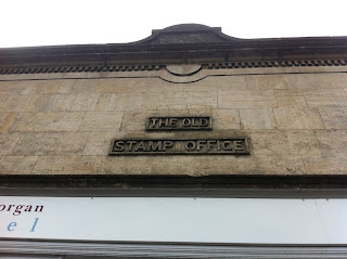 Ghost sign for The Old Stamp Office, Nailsworth, Gloucestershire