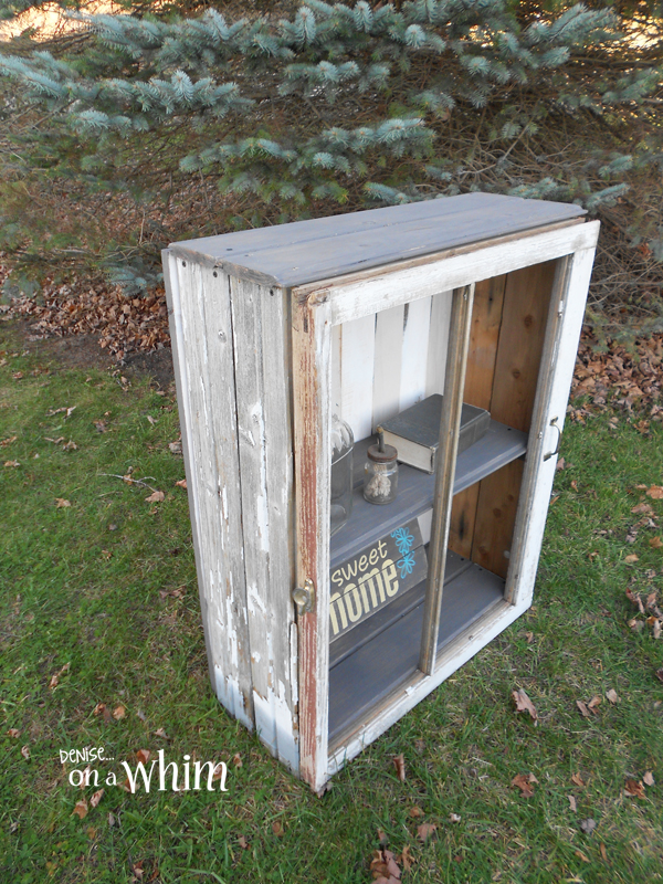 Rustic Cabinet Made with a Chippy Old Window and Weathered Wood Siding | Denise on a Whim