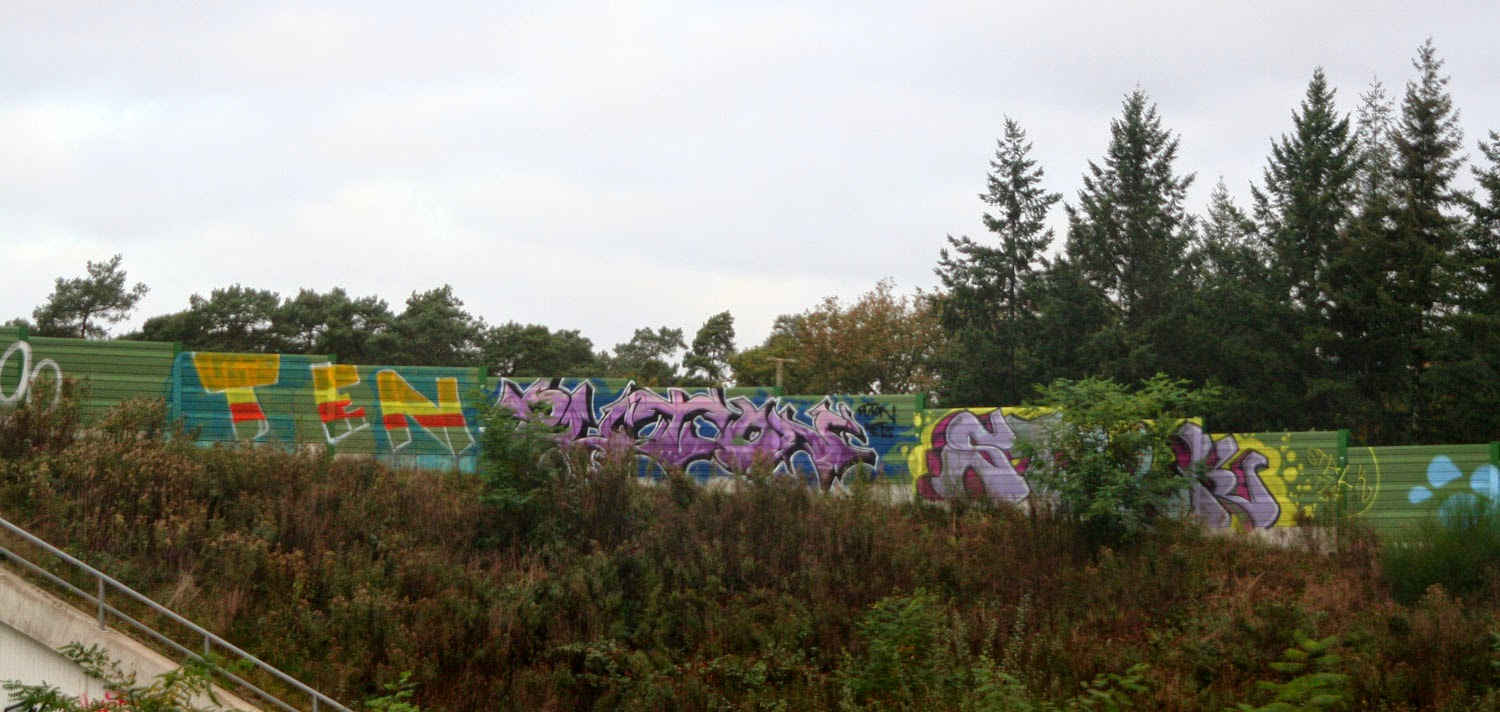 Colourful graffiti adds interest to concrete walls