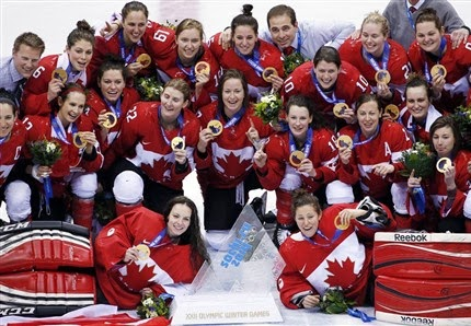 Team Canada women's hockey with their gold medals