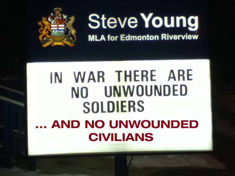 lest we forget there are no unwounded civilians either. sign by Steve Young. Photo and edit by rob g