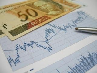 Foto de Gráfico e Dinheiro