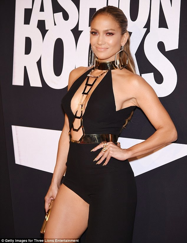 The singer put a very passionate display in a long black dress by split up the side of her long legs number around the red carpet of Fashion Rocks in Brooklyn, New York in Tuesday, September 9, 2104.