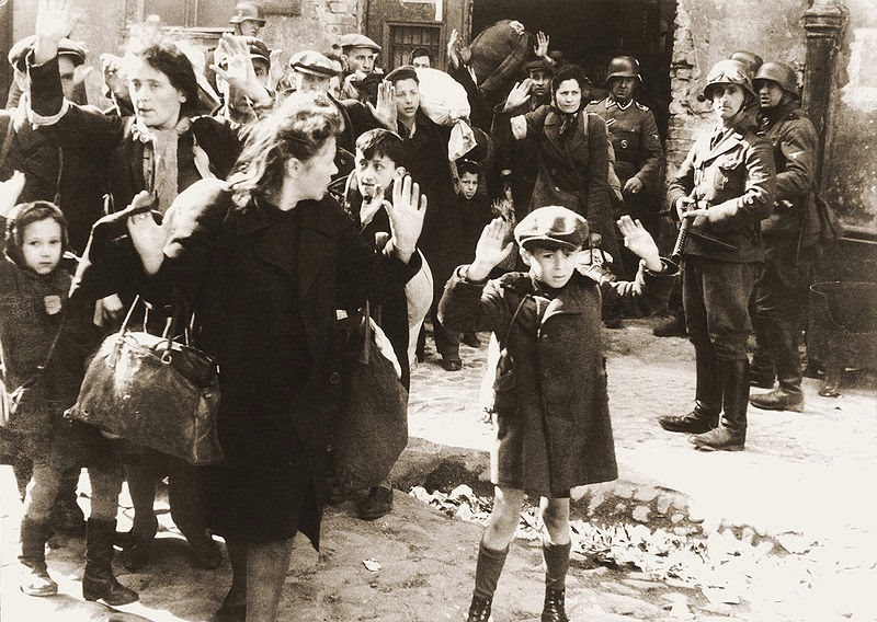 German soldiers removing Jews from the Warsaw Ghetto. (Photo from Wikimedia Commons)
