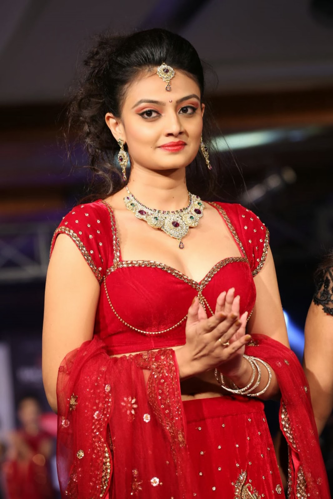 Glamorous Nikitha narayan in ethnic Indian red lengha choli dress