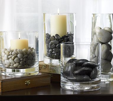 Using rocks as vase fillers for candles is a great way to bring a natural element to your decor