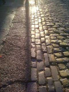 Sunlit coblestones in East London