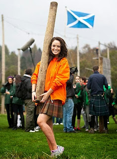 girl tossing caber