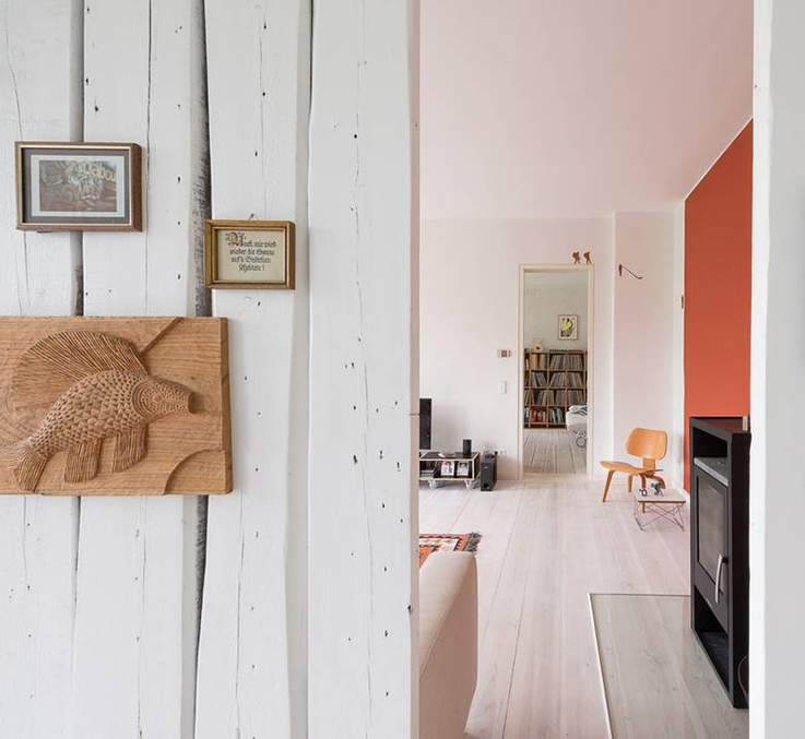 white interior with bright orange wall