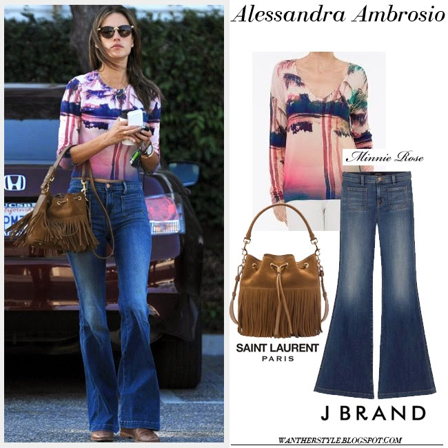 Alessandra Ambrosio in pink palm print top, blue denim flare J Brand Demi jeans and brown fringe Saint Laurent Emmanuelle bucket bag streetstyle inspo 70 fashion trend want her style