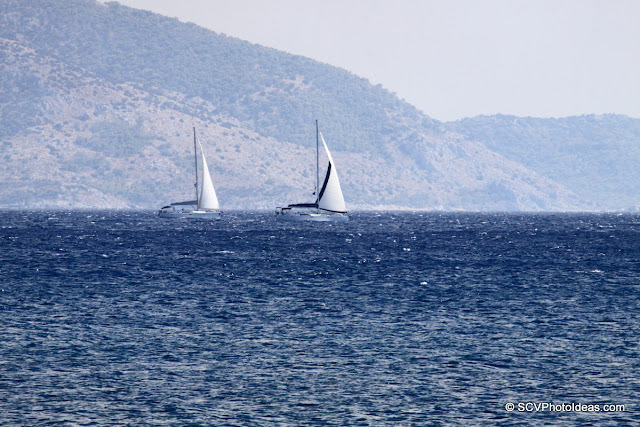 Two sailboats in the horizon