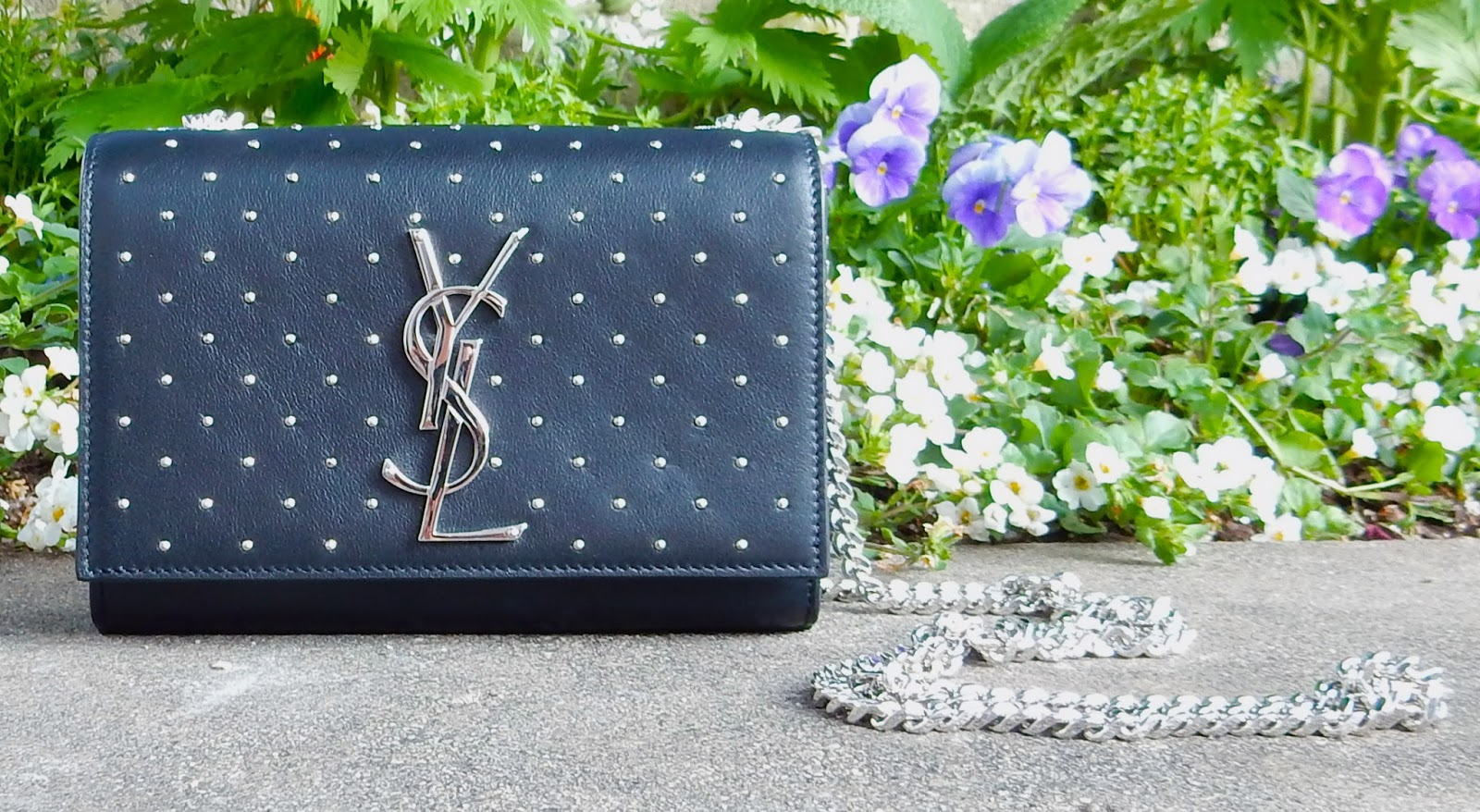 Beautiful studded YSL Crossbody Bag covered in studs and a YSL emblem.