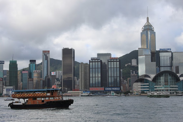 Chinese boat sailing along Victoria Harbour in Hong Kong