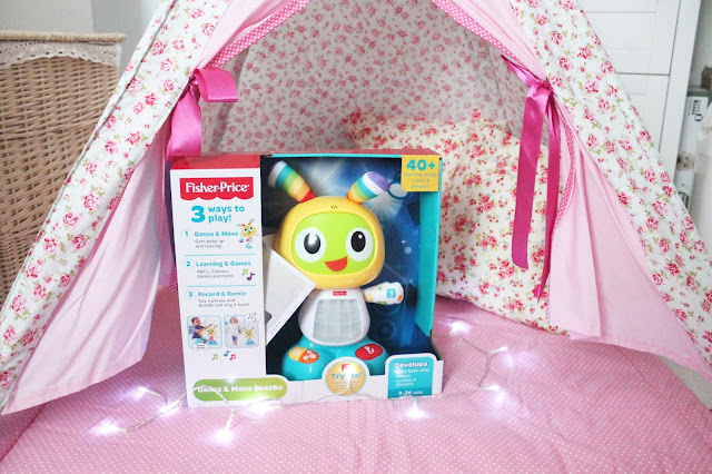 baby's first christmas gift guide pink floral tepee fisher price beat bo and fairy lights