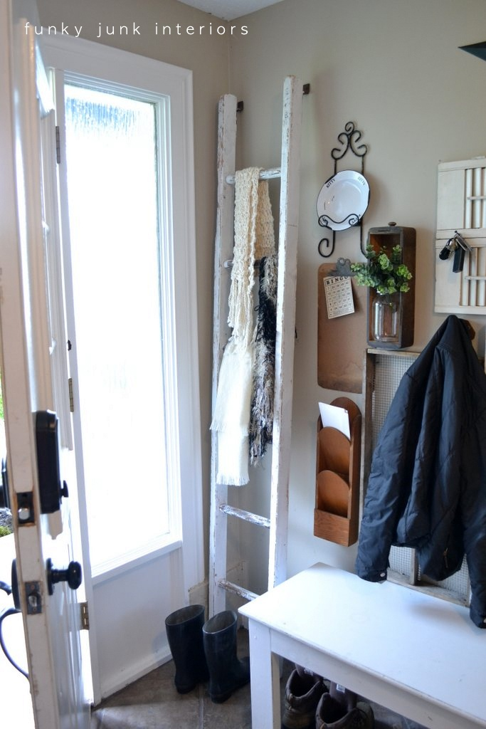 Storing and displaying scarves on an old ladder, via Funky Junk Interiors.