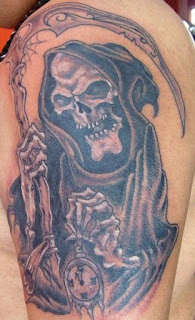 Death tattoo covering the shoulder and the arm: Grim Reaper holding a timepiece