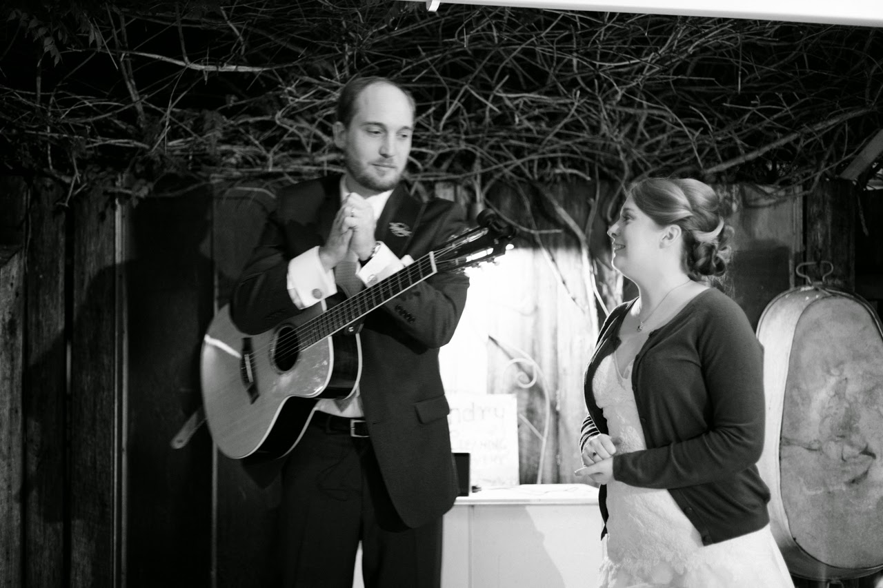 singing and guitar at wedding