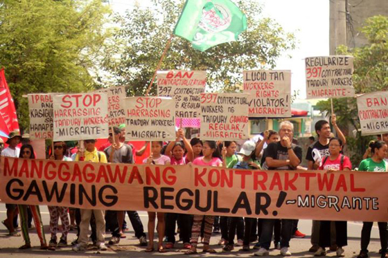 "The banner reads: ""Regularize contractual workers!"" Photo Credits: ST Exposure"