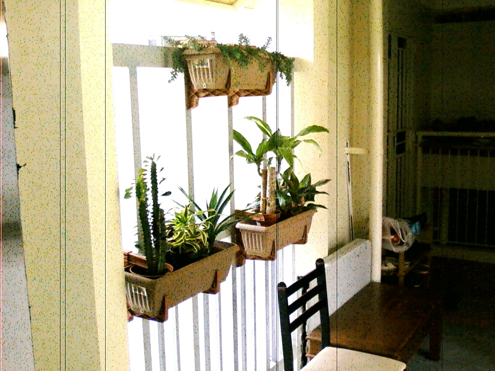 Pretty gardens deck rail planter makes great small space for Balcony planters