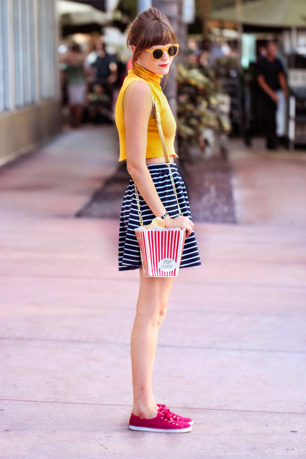 crop top, striped skirt, keds, popcorn bag