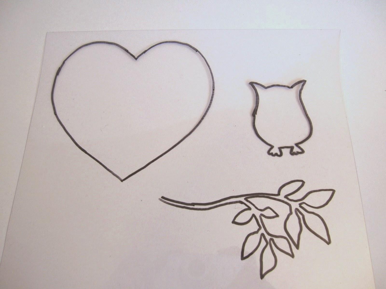hoja de acetato transparente con dibujo de corazón, búho y rama