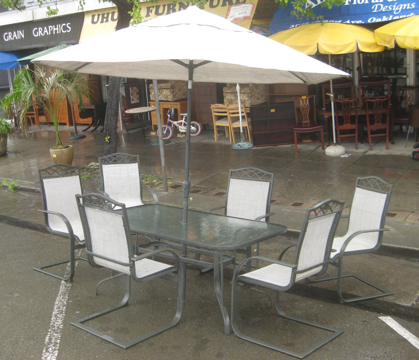 Uhuru furniture collectibles sold patio table for Outside table and chairs with umbrella