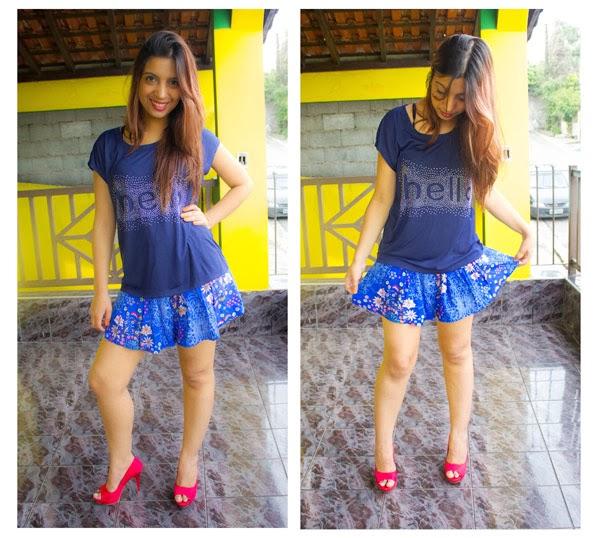 Blusa azul marinho com estampa prateada e Short saia floral