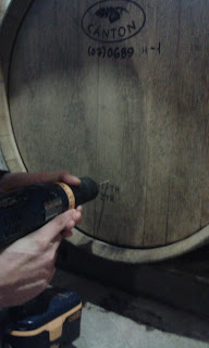 Drilling a small hole into the barrel.