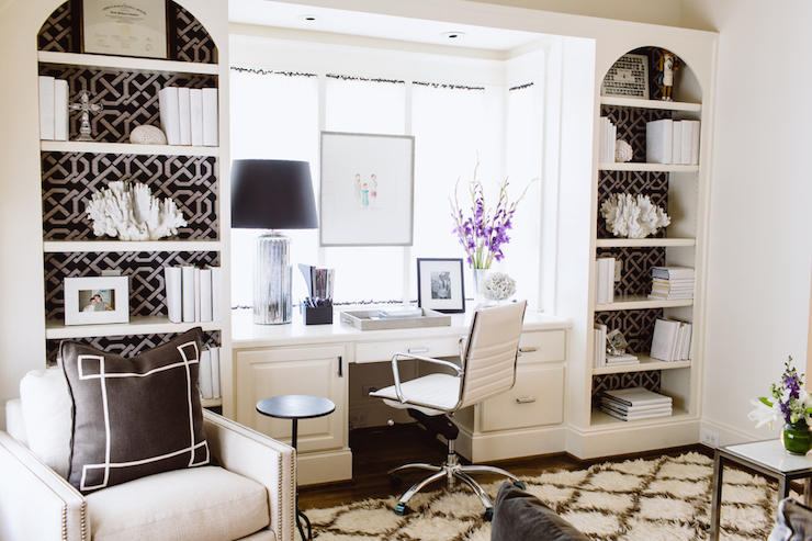 Give your bookcases/shelves a high end look by lining them with black  wallpaper!