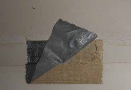 Tape removal from art, art conservation, paper, tear and puncture repair and restoration