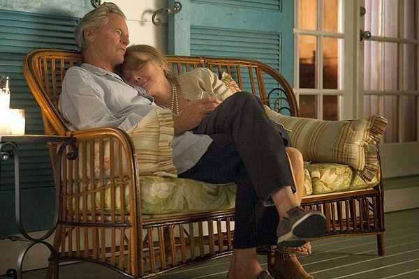 Papá y Mamá Rayburn en el porche de su querido y precioso hotel de Florida