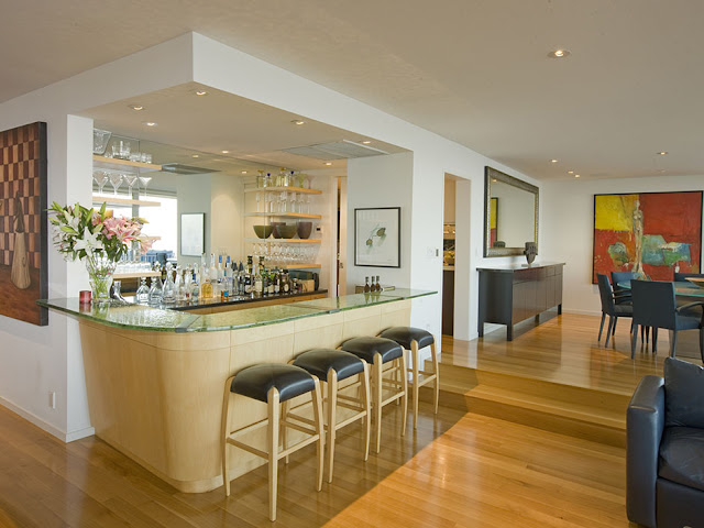 Picture of private wooden bar and four bar chairs in the modern mansion