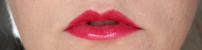 Michael Kors lipstick and lip gloss on the lips