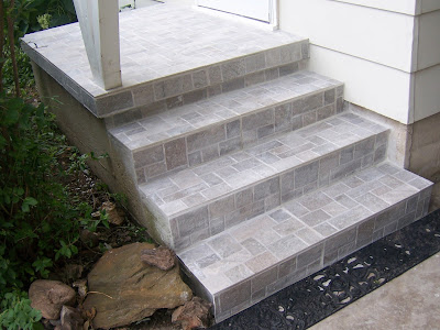 Professionally installed porcelain tile covers old concrete steps.