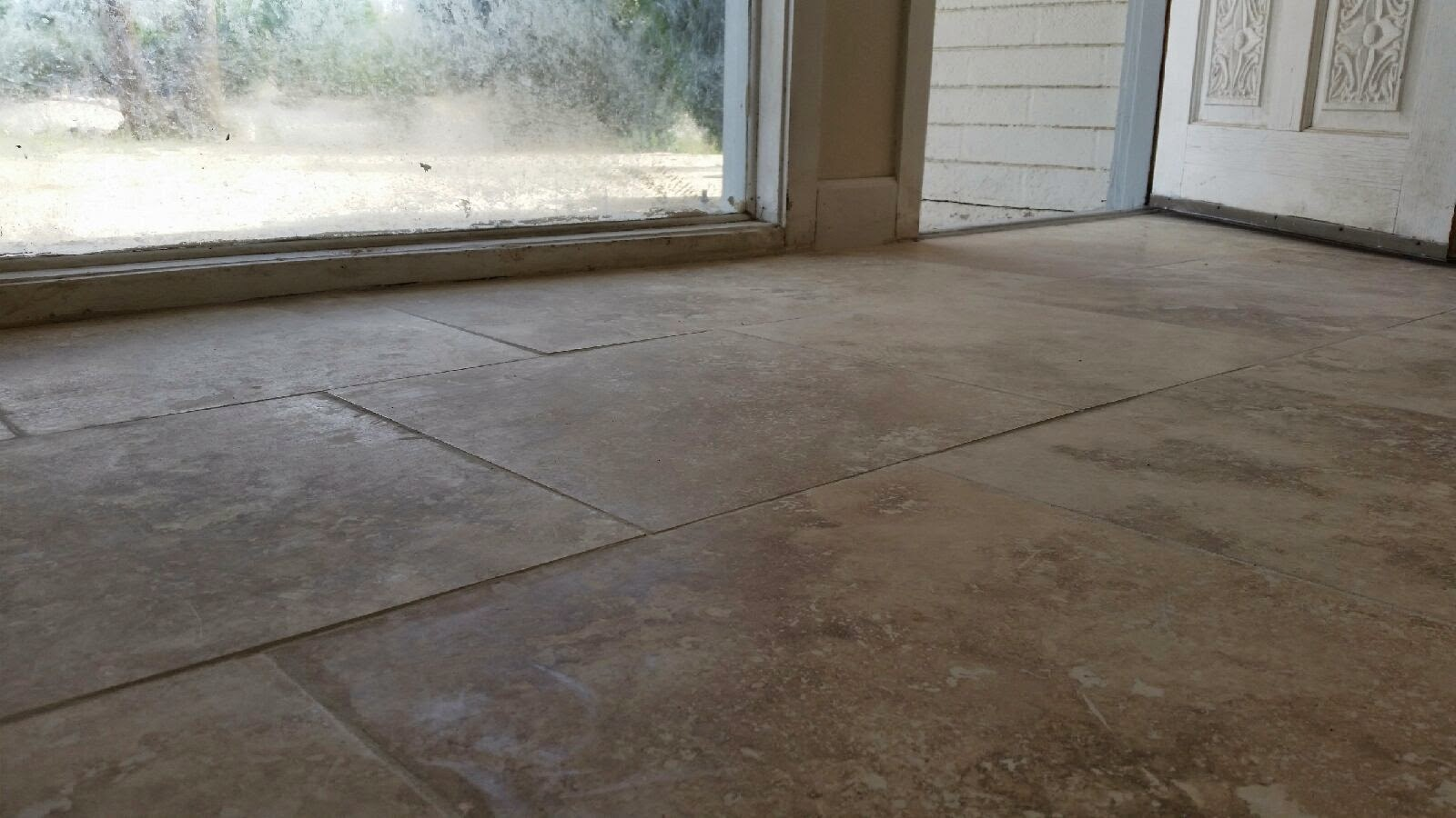 Pay top dollar for travertine tile flooring make sure you dont this is a very bad installation dailygadgetfo Choice Image