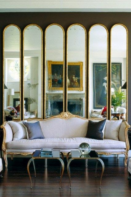 repetition of arched mirrors, mirrors living room, mirrors impact