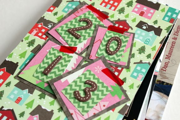 I like to use number stickers to signify the year that the Christmas Cards are from. I just cut out some more wrapping paper and added it to the front of the book along with the numbers.