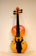 The original student grade violin with the strings and other violin stuff .