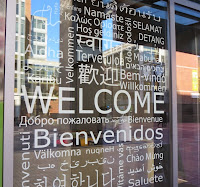 A Window in the University Welcome Center: Welcome in many languages!