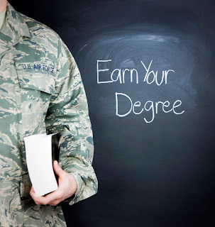 "image of a soldier standing next to a chalk board with caption that reads, ""Earn your degree."""