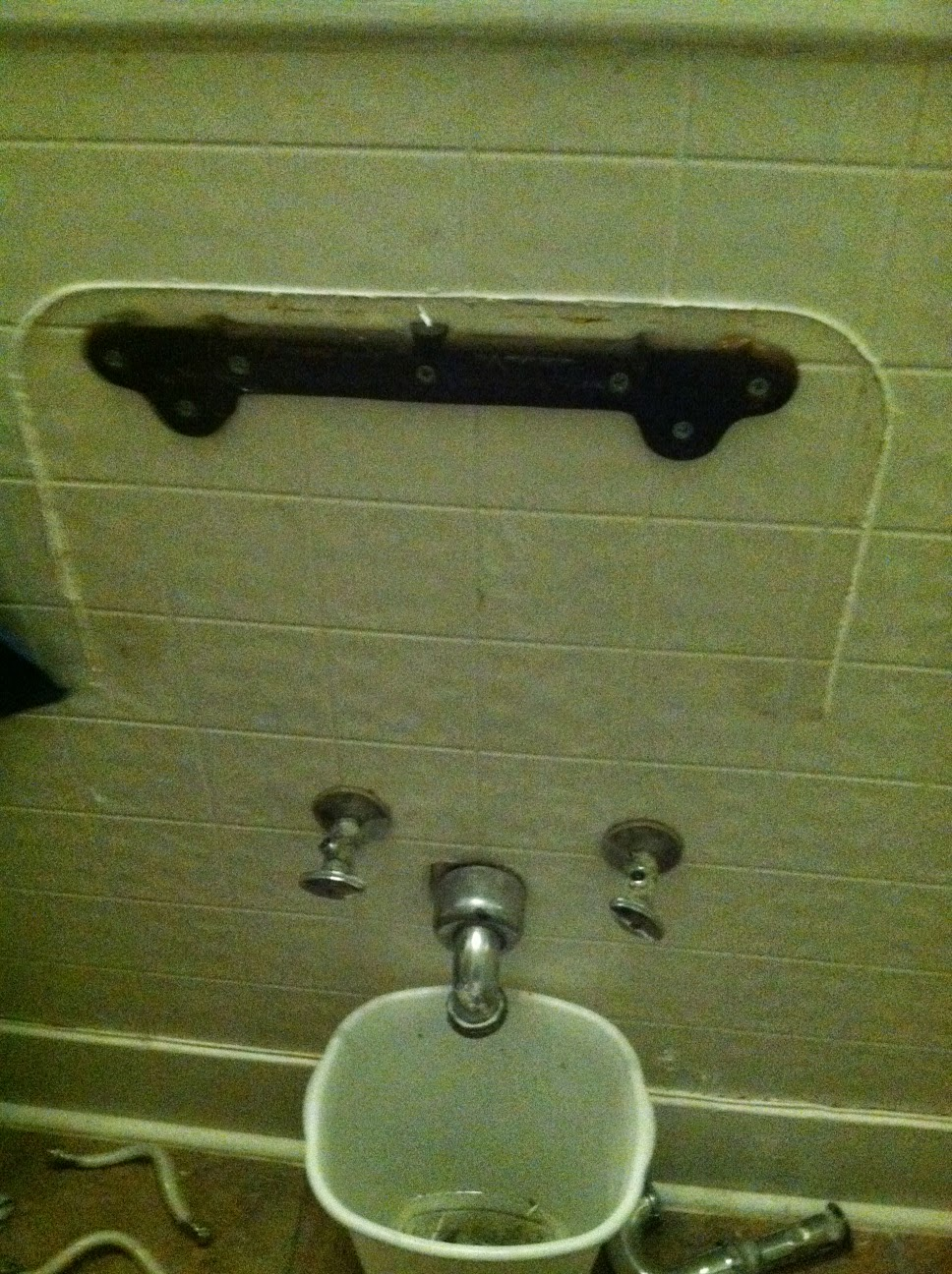 Lift old sink of wall mount bracket